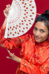 Asian woman with fan