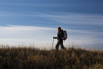 Female hiker walks along the ridge