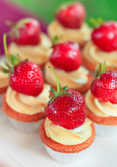 Cup-cakes with strawberry close-up