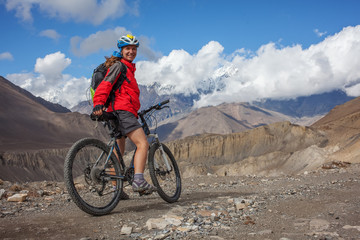 Biker-girl in Himalaya mountains, Anapurna region