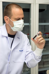 Doctor in lab examines blood