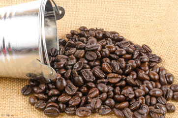 roasted coffee beans from can on sack cloth