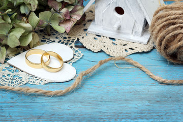 pair of wedding rings on old style background