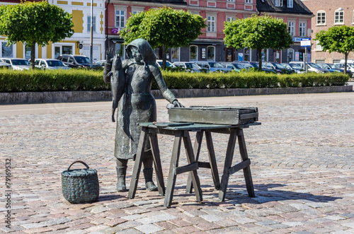 Statue of woman selling fish in Karlskrona.