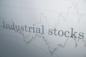 """Inscription """"Industrial stocks"""" on PC screen. Financial concept."""