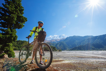 Biker-boy in Himalaya mountains, Anapurna region