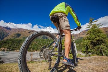 Biker-boy in Himalaya mountains, Anapurna region
