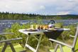 Leinwandbild Motiv Campingfrühstück am Fluß