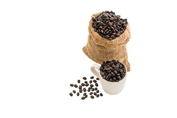 coffee beans in bag and white coffee cup