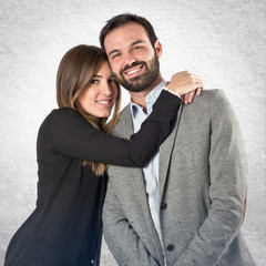Cute couple over white background.