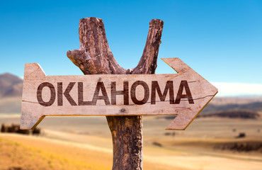 Oklahoma wooden sign with a desert background