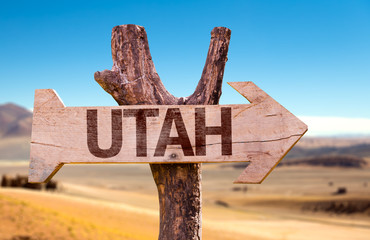 Utah wooden sign with a desert background