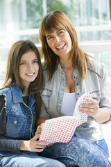 Happy Mother and Daughter Studying