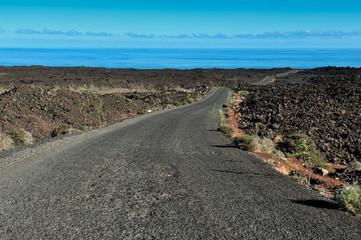 a road on volcanic landscape at  Lanzarote Island, Canary Island