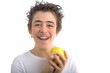 smiling boy holding a yellow apple