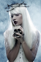 angelic long hair woman with skull
