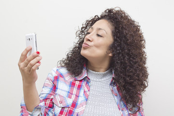by becoming a portrait brunette woman with the phone