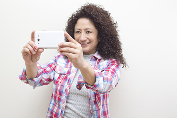 a portrait brunette woman with the phone