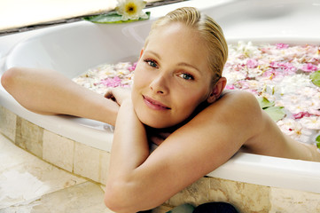 young woman bathing in a health spa's flower bath.