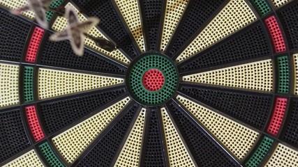 Playing darts hitting target on game board