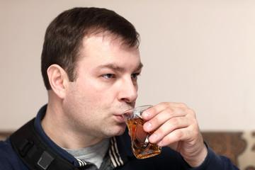 Man drinking black tea