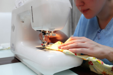 Woman at the sewing machine