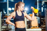 Fitness woman exercising crossfit holding kettlebell strength poster