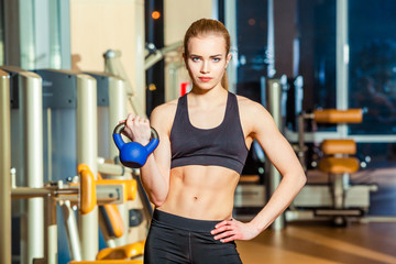 Fitness woman exercising crossfit holding kettlebell strength