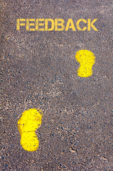 Yellow footsteps on sidewalk towards Feedback message