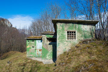 Hunting cabin in the meadow in the mountains