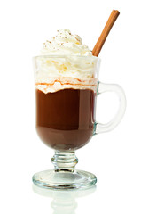 Hot chocolate in a glass with whipped cream and cinnamon