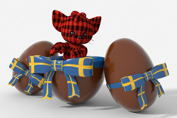 Uovo di Pasqua cioccolato con colori Svezia e peluche
