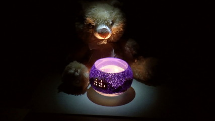 Teddy bear with a candlestick