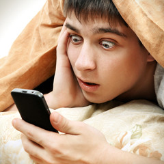 Surprised Teenager with Cellphone