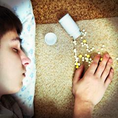 Teenager sleep near the Pills