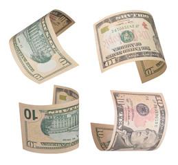 Set of flying ten dollars bills. Isolated on white