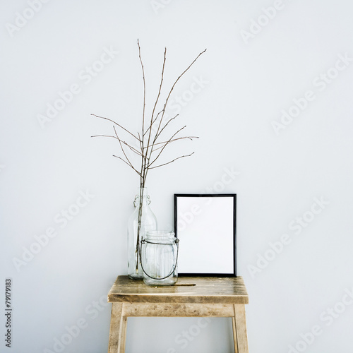 black frame with glass bottles. Scandinavian room. Mock up Photo by Jusakas