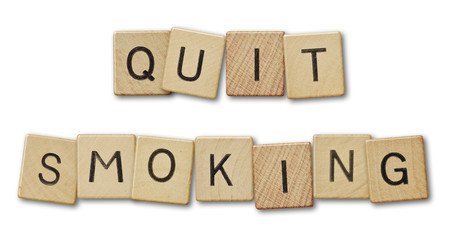 Text quit smoking.Scrabble pieces isolated on white