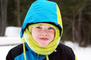 Cute boy in winter gear