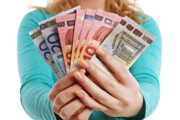 Hände voller Geld