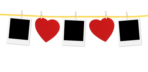 Vintage photos frame on the clothesline with hearts over white