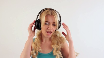 Young blonde girl with long hair on the head with headphones