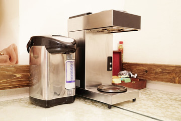 Close Up of electric water boiler pot and coffee machine