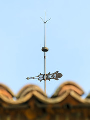 Lightning rod and weather-vane over diffused tiles