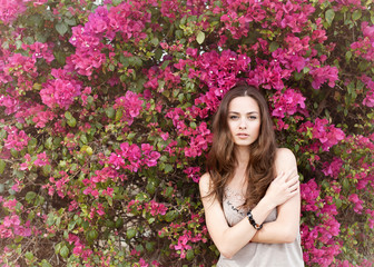 portrait of a beautiful brunette girl in summer colors flowers