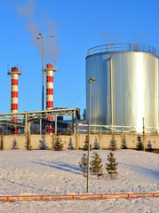 Boiler tube urban winter against the blue sky