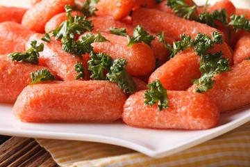 Glazed carrots with parsley on a plate macro. horizontal