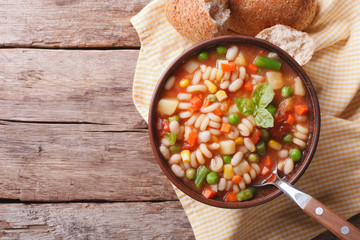 minestrone soup and bread on the table. horizontal top view