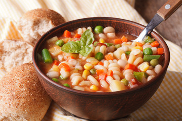 Italian minestrone soup in a bowl close up. Horizontal