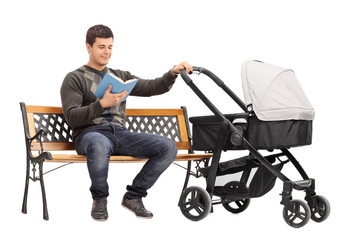 Young man holding a baby stroller and reading book